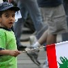 Little Boy walking with a Flag