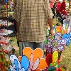 Man selling colorful gadgets at garden show