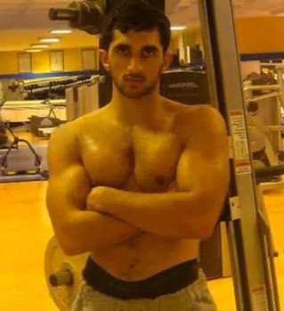 Sexy Arab Prince Muscles Sheikh Rashid al Maktoum at the gym working out and flexing photo